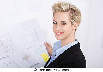 Smiling successful businesswoman at her desk