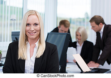 Smiling successful manageress