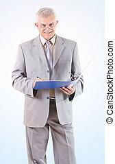 Smiling Successful Senior Businessman signing documents