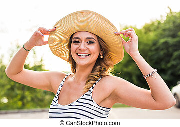 Smiling summer woman with hat