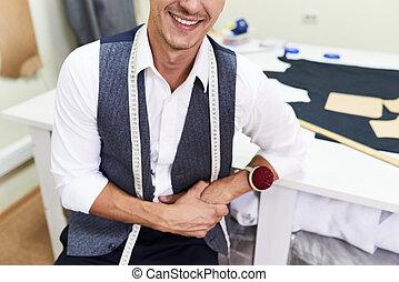 Smiling Tailor in Modern Atelier