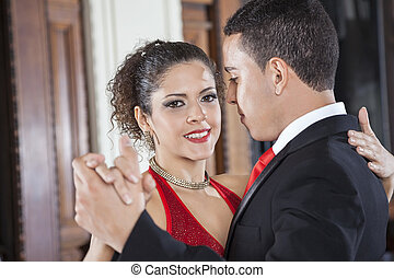 Smiling Tango Dancer Performing Gentle Embrace Step With Man...