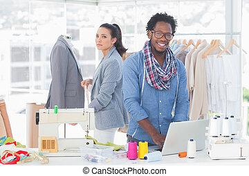 Smiling team of fashion designers