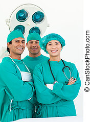 Smiling team of surgeon in the hospital