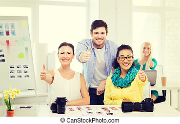 smiling team with photocamera in office