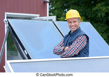 smiling technician of solar panels