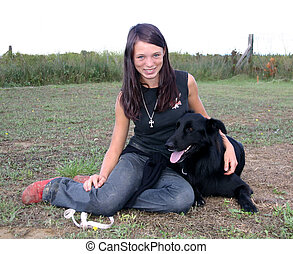 smiling teen and dog