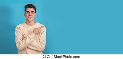 smiling teen boy pointing isolated
