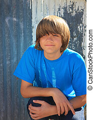 Smiling teen boy - portrait of a cute teen boy with...