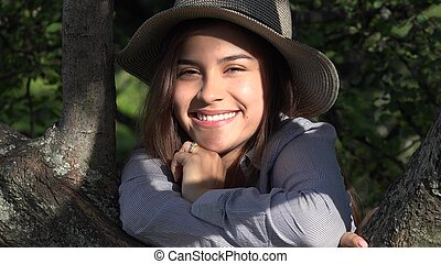 Smiling Teen Girl At Park On Sunny Day