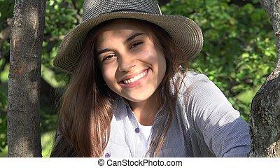 Smiling Teen Girl At Park