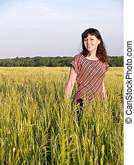 Smiling Teen Girl in Field