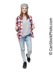 Smiling teen girl in full length giving double thumb up - ...