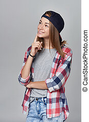 Smiling teen girl looking at copy space