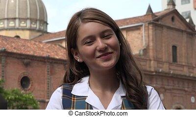 Smiling Teen Girl Near Church