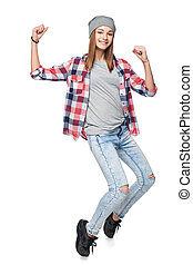 Smiling teen girl standing in full length gesturing success...