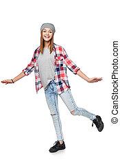 Smiling teen girl standing on one leg