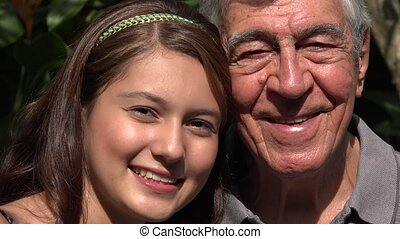 Smiling Teen Girl With Grandfather