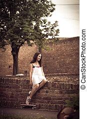 teen girl with skate
