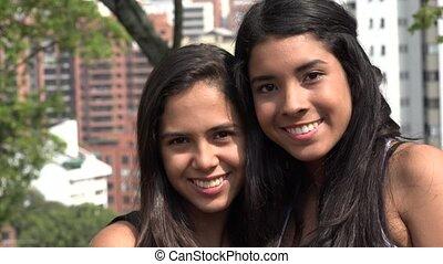 Smiling Teen Girls at Public Park