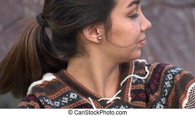 Smiling Teen Hispanic Girl Wearing Knit Sweater