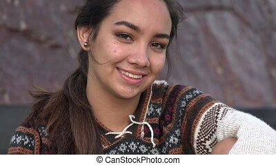 Smiling Teen Peruvian Girl Wearing Knit Sweater
