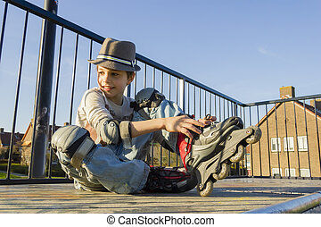 smiling teenage boy in roller-blading protection kit