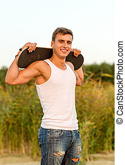 smiling teenage boy with skateboard outdoors - leisure,...