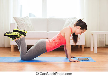 smiling teenage girl doing push-ups at home - fitness, home...