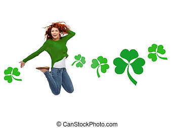 motion, happiness, st. patricks day and people concept - happy teenager girl jumping in air over white background with green shamrock or clover