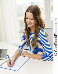 smiling teenage girl laptop computer and notebook - ...