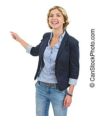 Smiling teenage girl pointing back on copyspace