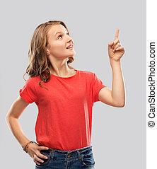 smiling teenage girl pointing finger to something