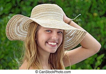 smiling teenage girl with hat