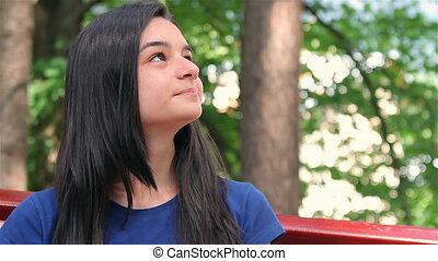 Smiling teenager girl relaxing