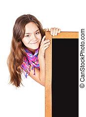 smiling teenager holding blackboard over white