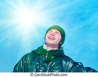 Smiling teenager on blue sky background