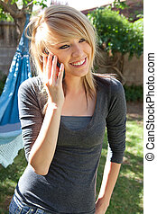 Smiling Teenager on Mobile Phone