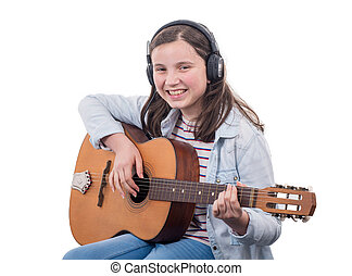 smiling teenager playing guitar on the white background