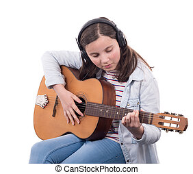 smiling teenager playing guitar on white background