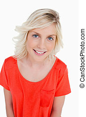 Smiling teenager standing up and looking at the camera against a white background