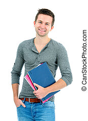 Smiling teenager with schoolbooks and hand in pocket