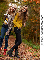 Smiling teenagers in the forest