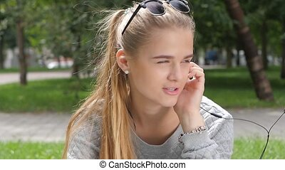 Smiling teenagers, students in sunglasses having fun outside. slow motion