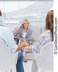 Smiling therapist speaking a couple
