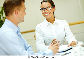 Smiling to colleague - Image of a beautiful office worker ...