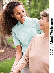 Smiling to elder woman