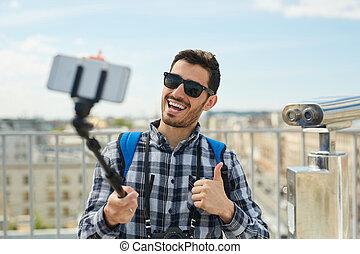 Smiling Tourist Taking Selfie