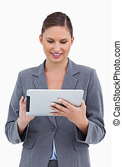 Smiling tradeswoman using her tablet computer