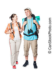 smiling travelers with backpacks on a white background